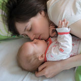 Baby with mom. In the bed Stock Photo