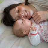Baby with mom Stock Photography