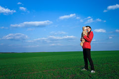 Baby with mom. Little baby with mom on green grass and blue sky background Royalty Free Stock Photo