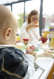 Baby and Mom at Breakfast Table Stock Photos