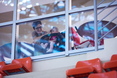 Baby and mom looking trough window Royalty Free Stock Photos
