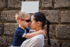 Baby and mom near a stone wall Royalty Free Stock Photos