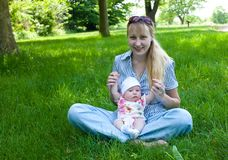 Baby and Mom Outdoors Royalty Free Stock Photos