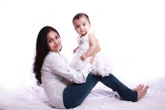 Baby and Mom. Portrait mom is holding her small baby,  against white background Stock Image