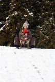 Baby and mom sledding royalty free stock images