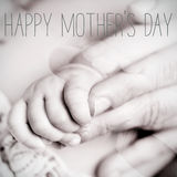 Baby and mom, and text happy mothers day Stock Image