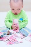 Baby with money in hand Royalty Free Stock Image