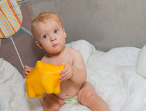 Baby with moneybox Royalty Free Stock Image