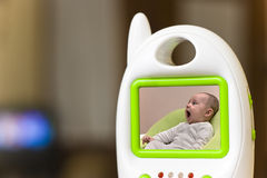 Baby monitor. Baby shown in baby monitor device Royalty Free Stock Photography