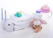 Baby monitor, diapers. Pacifier nipple. Toy hare banny , bottle - safety and care of the baby Royalty Free Stock Photography