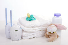 Baby monitor. Diapers. pacifier nipple. Toy hare - safety and care of the baby Royalty Free Stock Photo