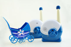 Baby monitor. With miniature old fashioned baby buggy carriage Royalty Free Stock Photo