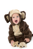Baby in monkey costume Stock Images