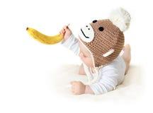 Baby in monkey hat Royalty Free Stock Photo