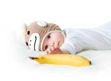 Baby in monkey hat Stock Images