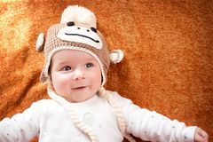 Baby in monkey hat Royalty Free Stock Photo