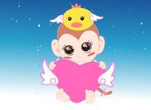 Baby monkey hug. Cute baby monkey hug the heart doll Royalty Free Stock Image