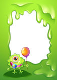 A baby monster with a balloon in front of the empty template Stock Photo