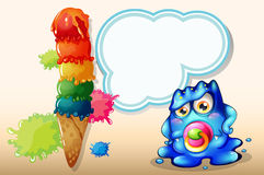 A baby monster with an empty callout near the giant icecream Royalty Free Stock Photos
