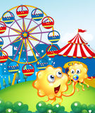A baby monster with her mother at the hilltop with a carnival. Illustration of a baby monster with her mother at the hilltop with a carnival Royalty Free Stock Photo