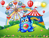 A baby monster at the hilltop with a carnival. Illustration of a baby monster at the hilltop with a carnival Royalty Free Stock Photos