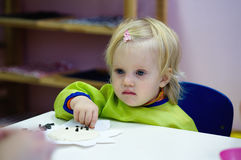 Baby in montessori class Royalty Free Stock Photo