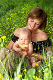BABY AND MOTHER. Little baby and her mother smiling stock images