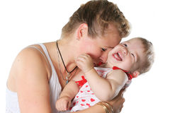 Baby and mother. Mother plays with the cheerful baby Royalty Free Stock Photography