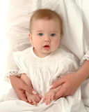 Baby with Mother. Baby girl being held in her mother's lap Royalty Free Stock Images