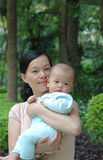 Baby and mother. It is a cute chinese baby and his mother in the outdoor. he is 5 months Royalty Free Stock Photography