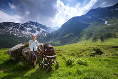 Baby and mother with the Alps mountains in nature in the Backgro Stock Photography