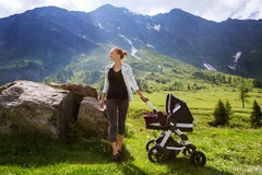 Baby and mother with the Alps mountains in nature in the Backgro Stock Images