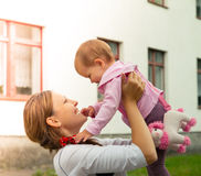 Baby with mother Stock Image