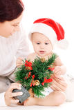 Baby and mother with christmas gifts Stock Images