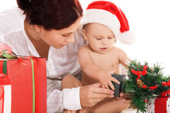 Baby and mother with christmas gifts Stock Photos