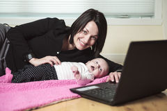 Baby mother computer Royalty Free Stock Photos