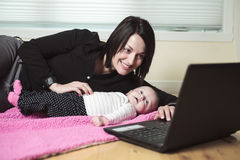 Baby mother computer Royalty Free Stock Image