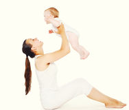 Baby and mother doing exercises Royalty Free Stock Photo
