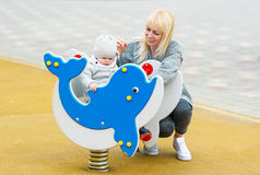 Baby, mother and dolphin. Stock Photos