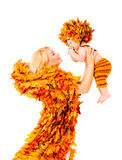 Baby and Mother in Fashion Autumn Fall Leaves Clothing. Mom Holding Kid, Isolated over White Stock Photography