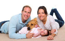 Baby mother and father happy family and dog. Baby mother and father happy family with golden retriever dog on carpet Royalty Free Stock Image