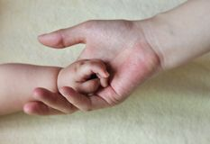 Baby and mother hands 2167. Hands touch between chinese mother and baby show family and love Stock Photos