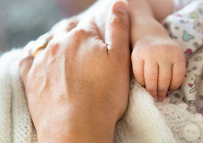 Baby and mother hands Stock Photo