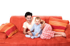 Baby and mother at home Stock Photos