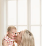 Baby and mother at home Stock Photo