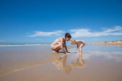 Baby and mother looking at seaside Stock Images