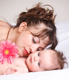 Baby and mother lying Royalty Free Stock Photo