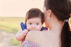 Baby with mother outdoor Royalty Free Stock Images
