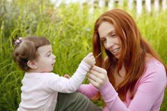 Baby and mother outdoor grass playing park Stock Image