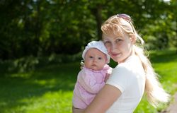 Baby and Mother Outdoors Stock Photo